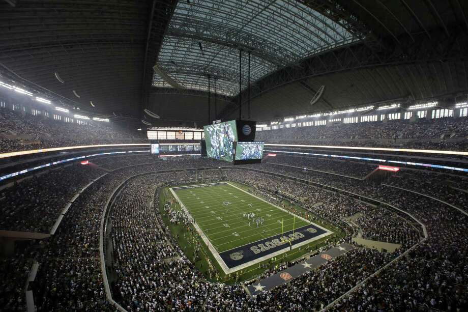 In this Sept. 8, 2013, file photo, fans watch at the start of an NFL football game between the New York Giants and Dallas Cowboys, in Arlington. The Dallas Cowboys not only are the NFL's most valuable franchise for the 11th straight year, they are the top-valued team in the world. According to Forbes magazine, their worth increased 14 percent in the last year, reaching $4.8 billion. Photo: Tony Gutierrez /Associated Press / Copyright 2017 The Associated Press. All rights reserved.