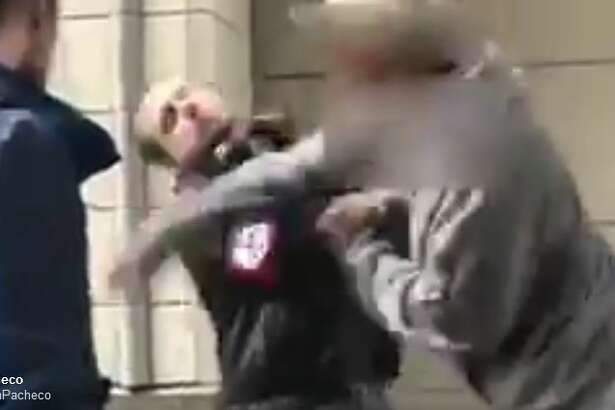 A bystander shoots video of someone punching a man wearing a swastika armband at Third Avenue and Pine Street in downtown Seattle. Seattle police say they found the man on the ground. He reportedly stood up and walked away, removing his armband.