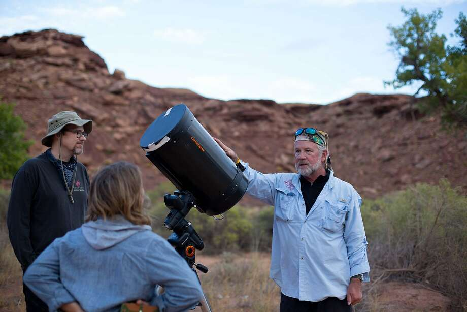 Tom Beckett, a lawyer, guide and astronomer, explains the nuances of his telescope. Photo: Sam Watson, Special To The Chronicle