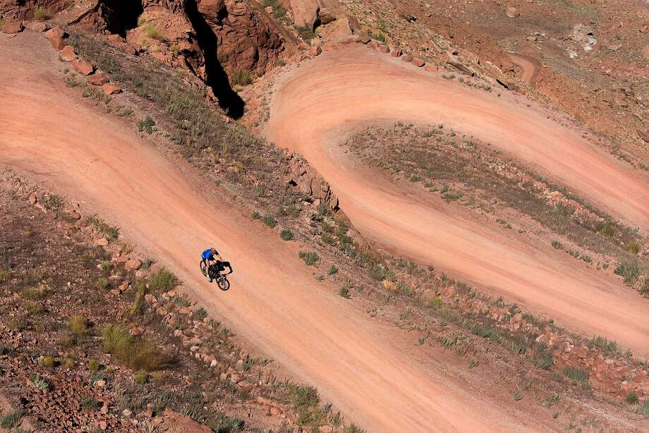 Mineral Bottom Switchbacks. White Rim cyclists are greeted with a 900-foot decent to the Green River at the start of their trip on the White Rim Trail. Photo: Sam Watson, Special To The Chronicle