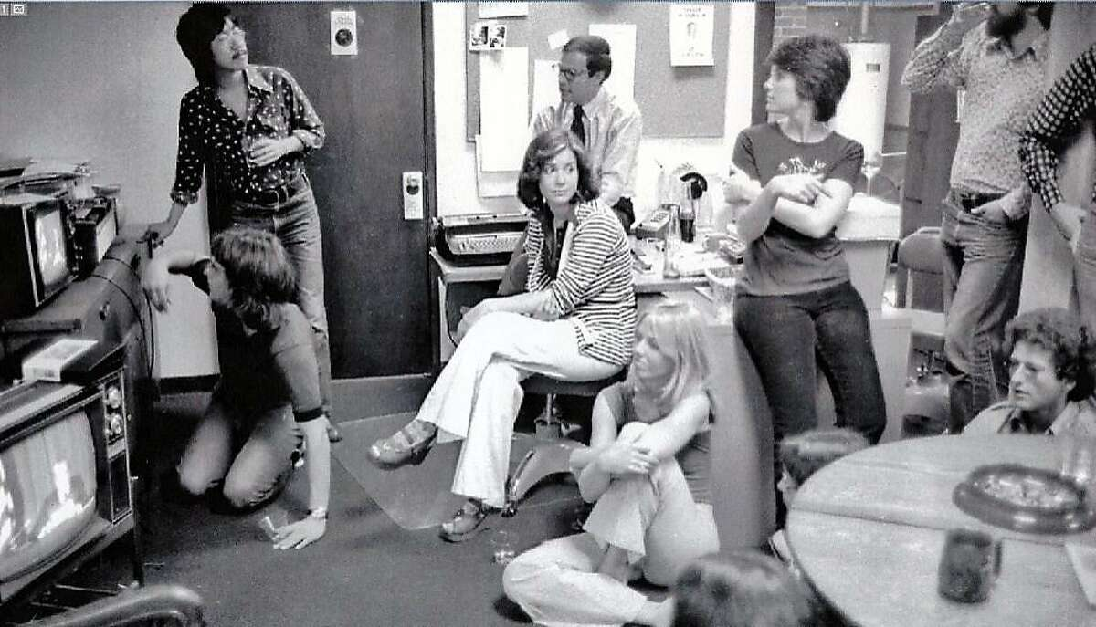 A group of Rolling Stone editors and staff members, including Ben Fong-Torres (standing left), watch President Nixon resign on television on August 8, 1974. The photo was taken in the magazine�s San Francisco office at 625 Third St.