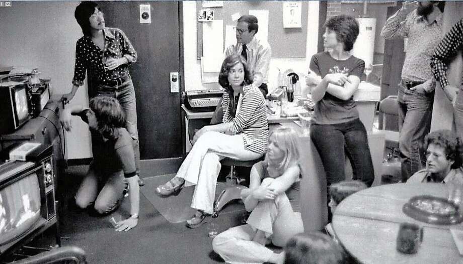 Rolling Stone staff members watch Pres ident Richard Nixon re sign on television in 1974 in the maga zine's San Francisco office. Photo: Courtesy Of Ben Fong-Torres