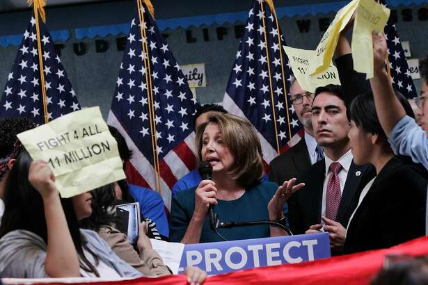 U.S. House Minority Leader Nancy Pelosi tries to tak as protesters demonstrate during a press conference on the DREAM ACT on Monday, September 18, 2017 in San Francisco, Calif.