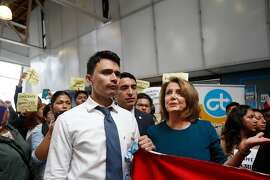 U.S. House Minority Leader Nancy Pelosi (right) tries to tak with Luis Angel Reyes Savalza (left)  of Oakland as he and other protesters demonstrate during a press conference on the DREAM ACT on Monday, September 18, 2017 in San Francisco, Calif. Savalza says he is undocumented and a DACA recipient.