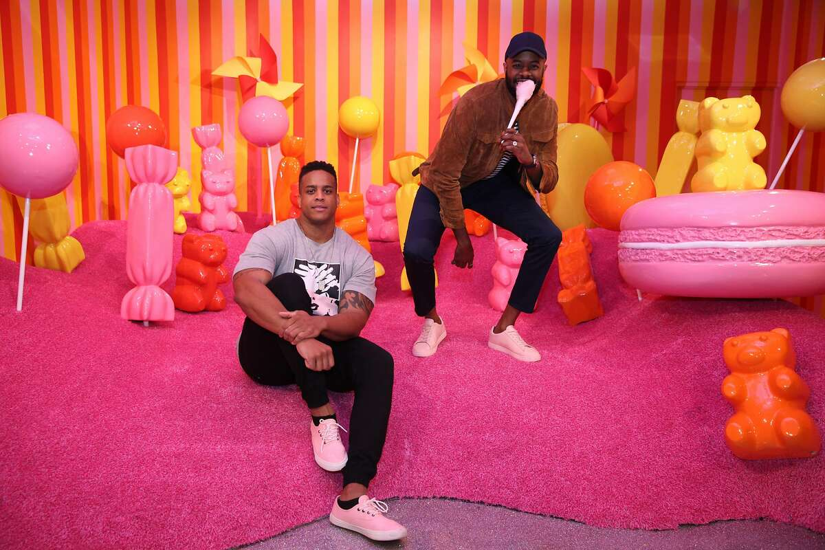 SAN FRANCISCO, CA - SEPTEMBER 15: Former Patriots defensive lineman Corey Lewis (L) and Thomas Drew pose for a photo at Museum of Ice Cream opening party on September 15, 2017 in San Francisco, California. (Photo by Kelly Sullivan/Getty Images for Museum of Ice Cream)