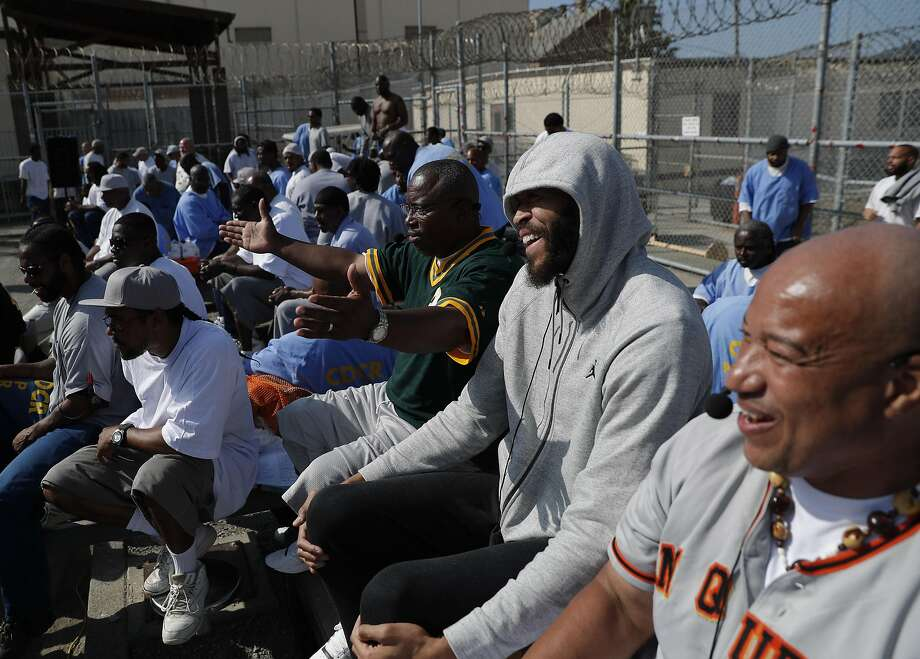 JaVale McGee helps announce a San Quentin Warriors pickup game during an annual trip to San Quentin Prison. Photo: Carlos Avila Gonzalez, The Chronicle