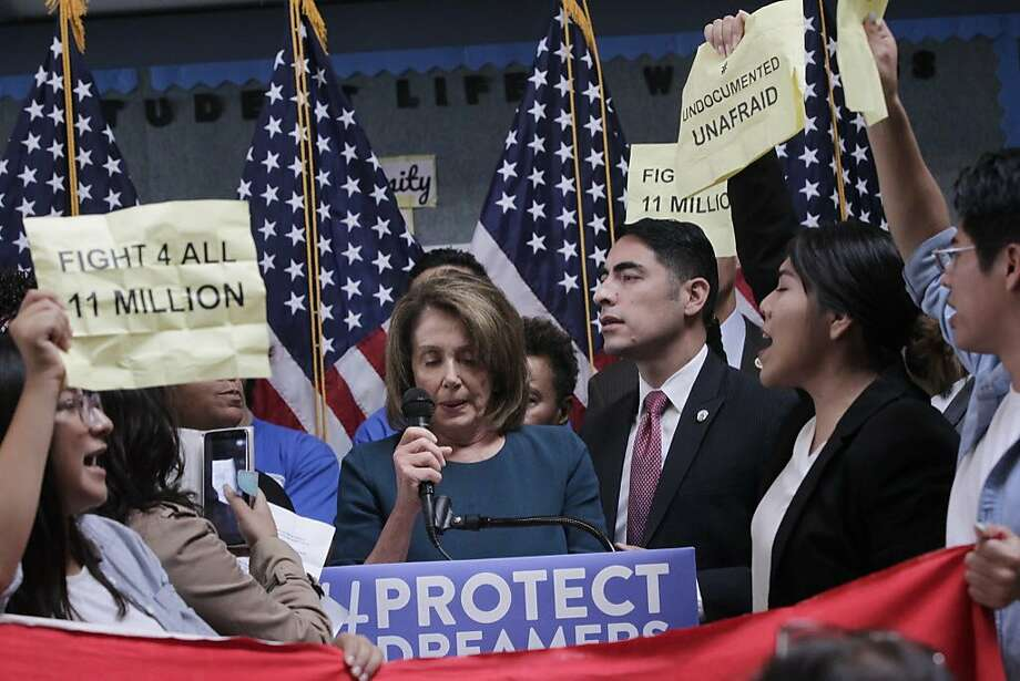U.S. House Minority Leader Nancy Pelosi tries to tak as protesters demonstrate during a press conference on the DREAM ACT on Monday, September 18, 2017 in San Francisco, Calif. Photo: Lea Suzuki, The Chronicle