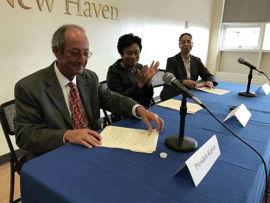 From left: University of New Haven PresidentSteven H. Kaplan, New Haven Mayor Toni Harp and New Haven Sister Cities President Shaundolyn Slaughter sign a memorandum of agreement creating a partnership between New Haven's sister cities program and the university on Monday, Sept. 18, at the University's campus in West Haven. Photo: Esteban L. Hernandez / Hearst Connecticut Media / Esteban L. Hernandez / Hearst Connecticut Media