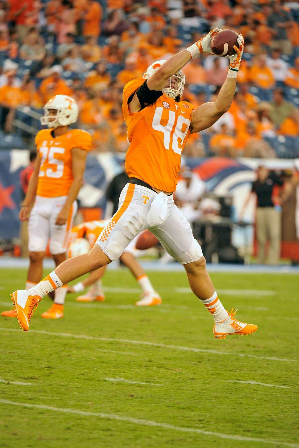 NASHVILLE, TN - SEPTEMBER 05: Alex Ellis #48 of the Tennessee Volunteers warms up prior to a game against the Bowling Green Falcons at Nissan Stadium on September 5, 2015 in Nashville, Tennessee. (Photo by Frederick Breedon/Getty Images)