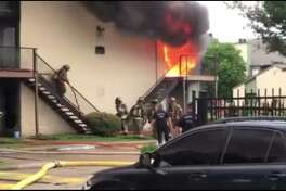 A fire at apartments on Corporate Drive, in southwest Houston. (Credit: Aaron Jackson)