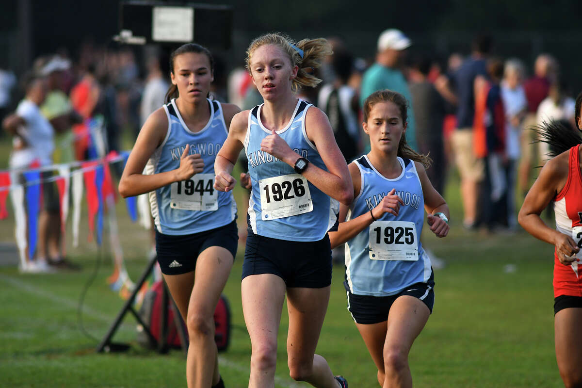 Kingwood's Daniella Wisniewski (1944), Rachel James (1926), and Jessica Hergott (1925) compete in the Varsity Girls 5K race at the Andy Wells Invitational at Atascocita High School on Sept. 16, 2017. (Photo by Jerry Baker)