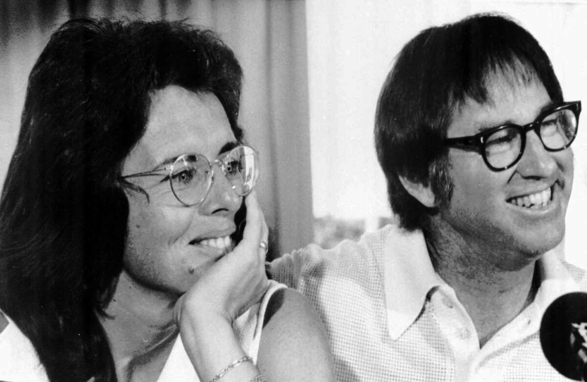 Billie Jean King and Bobby Riggs smile during a news conference in New York to publicize their upcoming match at the Houston Astrodome, July 11, 1973.