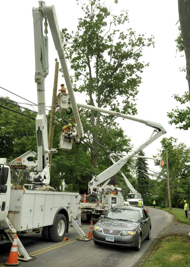 File photo of workers from the Powerline Division of Asplundh Construction Corporation work to restore downed power lines on Stadley Rough Road in Brookfield. Photographed Saturday, June 11, 2011. Photo: Michael Duffy / ST / The News-Times