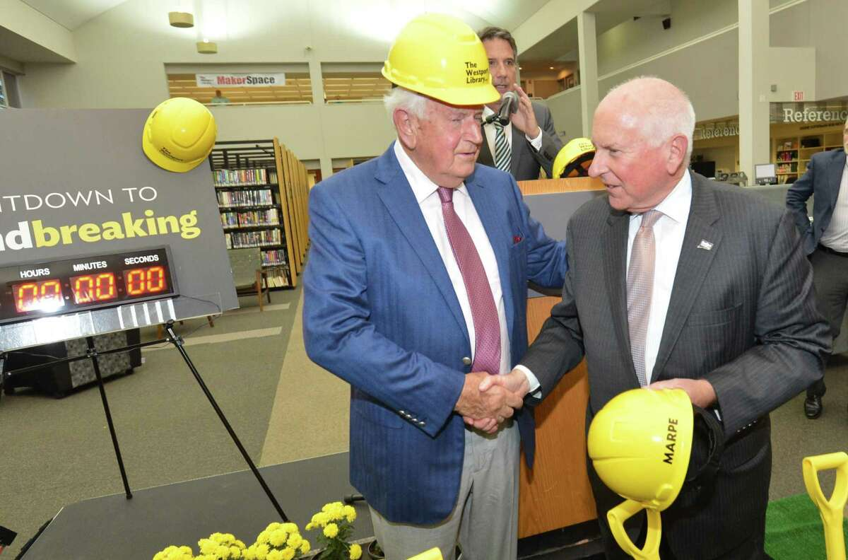 Cornerstone Society donor Christian Trefz shakes First selecman Jim Marpe's hand after a groundbreaking ceremony at the Westport Library on Thursday September 14, 2017 in Westport Conn. to announce the new library renovation and transformation project to begin in September