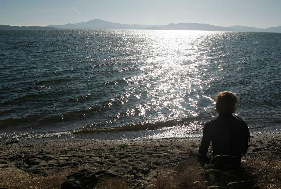 People enjoy their afternoon hiking at Point Pinole Regional Park, along the San Pablo Bay. Photo: Lacy Atkins, The Chronicle