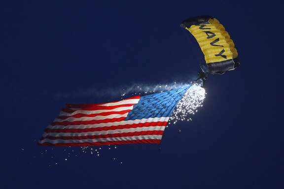 SALT LAKE CITY, UT - SEPTEMBER 16: A Navy Seal Team member parachutes in an American flag to start the game of the Utah Utes and the San Jose State Spartans on September 16, 2017 at Rice Eccles Stadium in Salt Lake City, Utah. (Photo by George Frey/Getty Images)