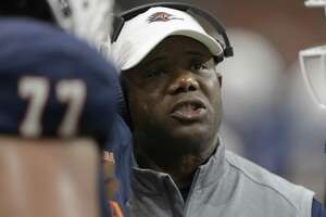 UTSA head coach Frank Wilson talks to his players during the second half against Southern on Sept. 16, 2017, in San Antonio.