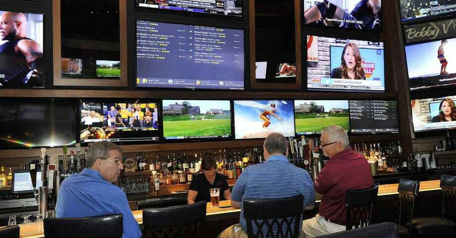 Patrons at the bar at Bobby V's Restaurant and Sports Bar in Windsor Locks. Sportech has a deal with a Danbury restaurant to build a similar sports bar and OTB parlor. Photo: / Carol Kaliff