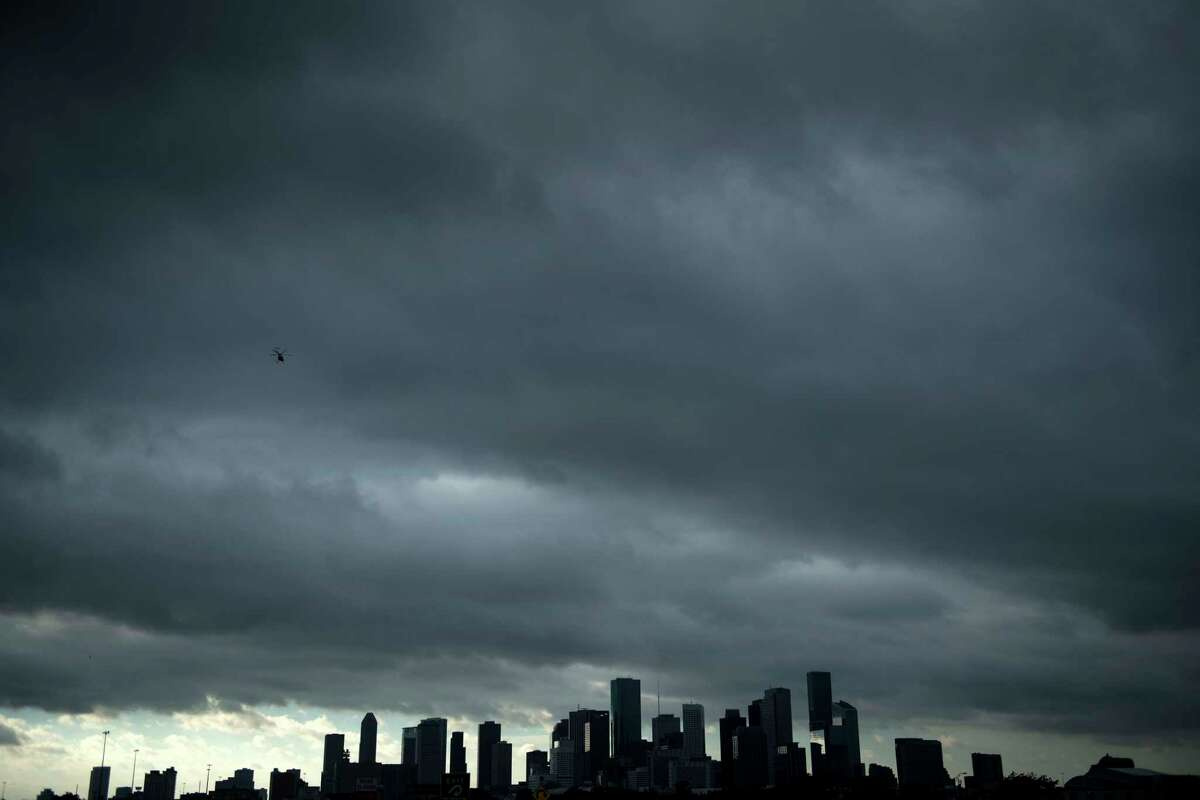 Dark clouds move in over the Houston skyline. Weather officials issued flash-flood warnings for some areas as the system moved through Monday. See images of Hurricane Harvey's impact on the Houston.