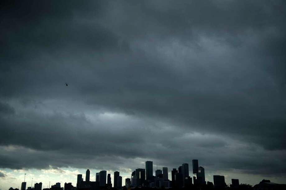 A view of the Houston skyline after heavy rains broke during the aftermath of Hurricane Harvey Aug. 29. (Brendan Smialowski/AFP/Getty Images) Photo: BRENDAN SMIALOWSKI, Contributor / AFP or licensors