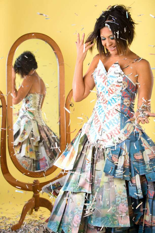 Nina Duran, daughter of late La Prensa publisher Tino Duran, wearing a dress made by Susie Hamilton from pages of the newspaper. Photo: Studio HighKey