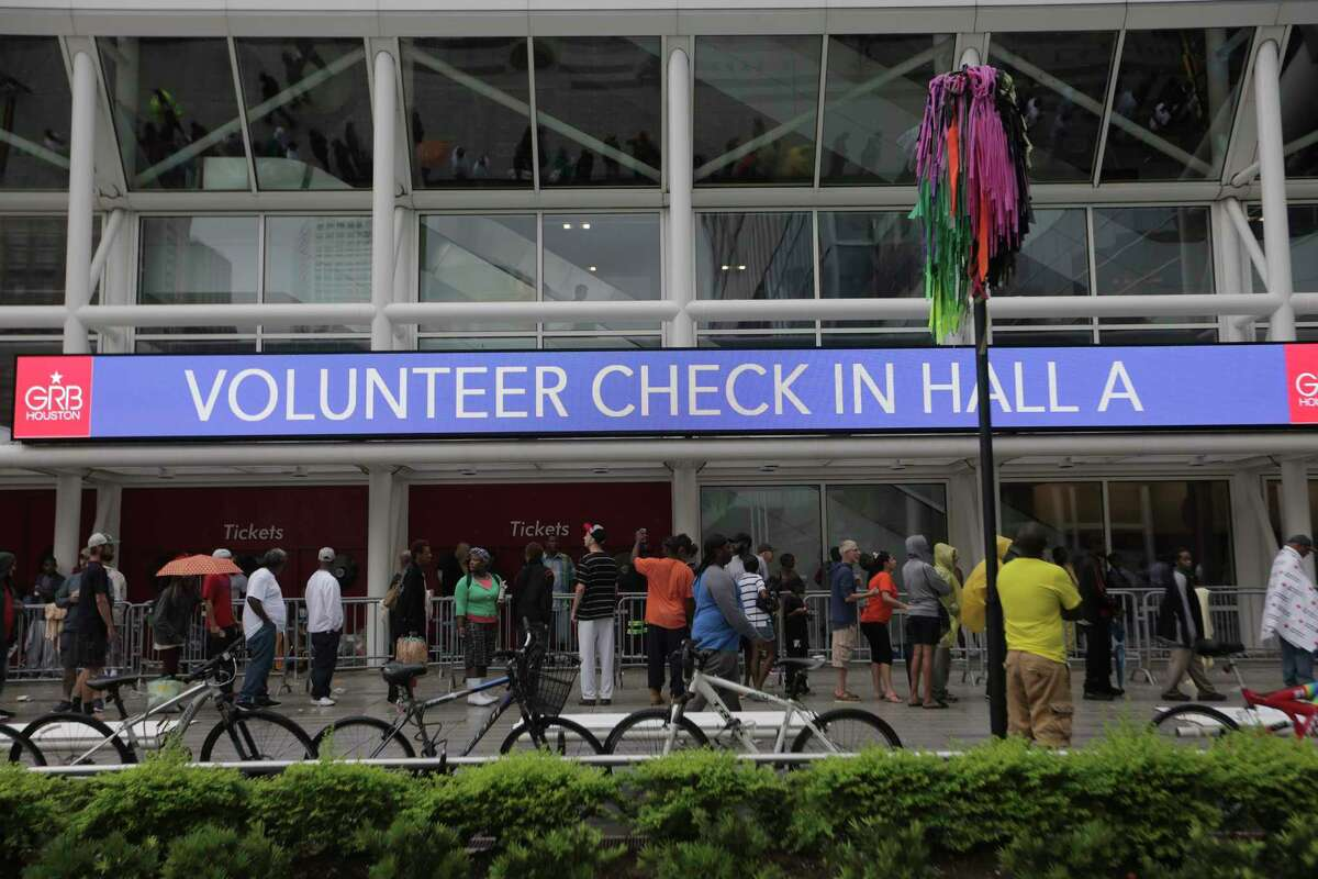 Evacuees line up outside the George R. Brown Convention Center in Houston on Aug. 29 because of the record rainfall and flooding caused by Hurricane Harvey. (Elizabeth Conley / Houston Chronicle )