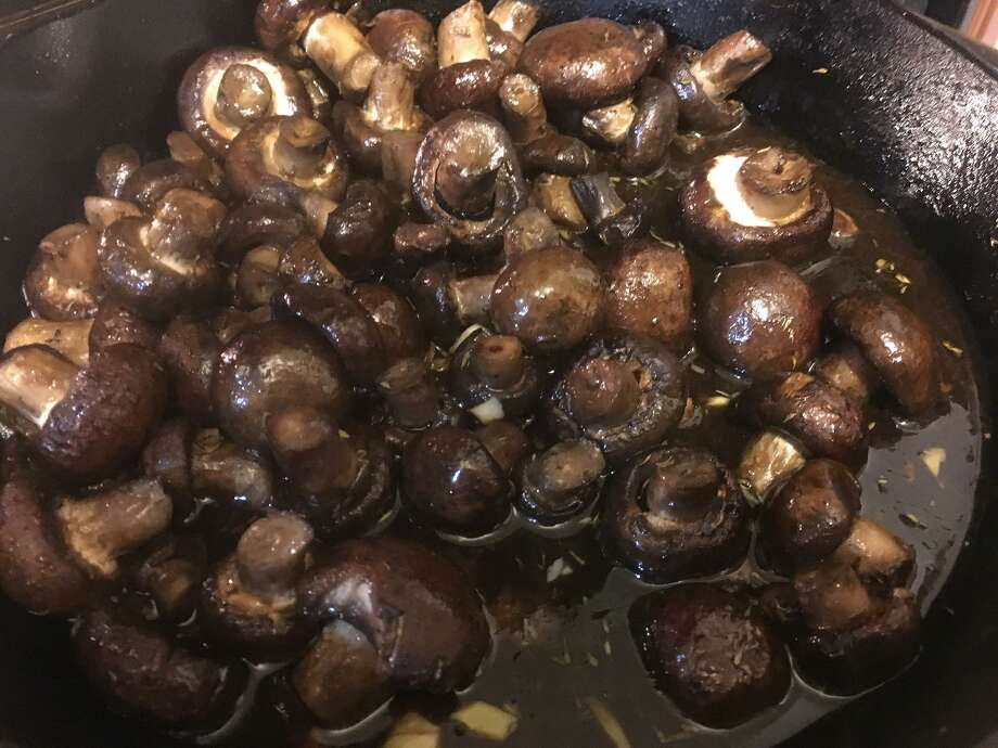 Balsamic soy roasted garlic mushrooms are a great tailgating option, because mushrooms can be stored at room temperature and can be cooked quickly on the grill. Photo: Chuck Blount / San Antonio Express-News