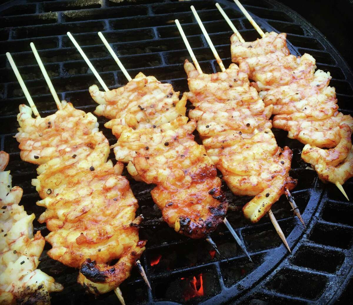Shrimp is a great option for the tailgate grill. Double-skewer them for easier handling, and apply a spicy sweet glaze with chile sauce and honey.