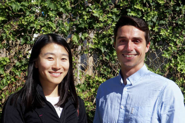 Loftium co-founders Yifan Zhang and Adam Stelle take a novel approach to down payment assistance. (GeekWire Photo / Monica Nickelsburg)