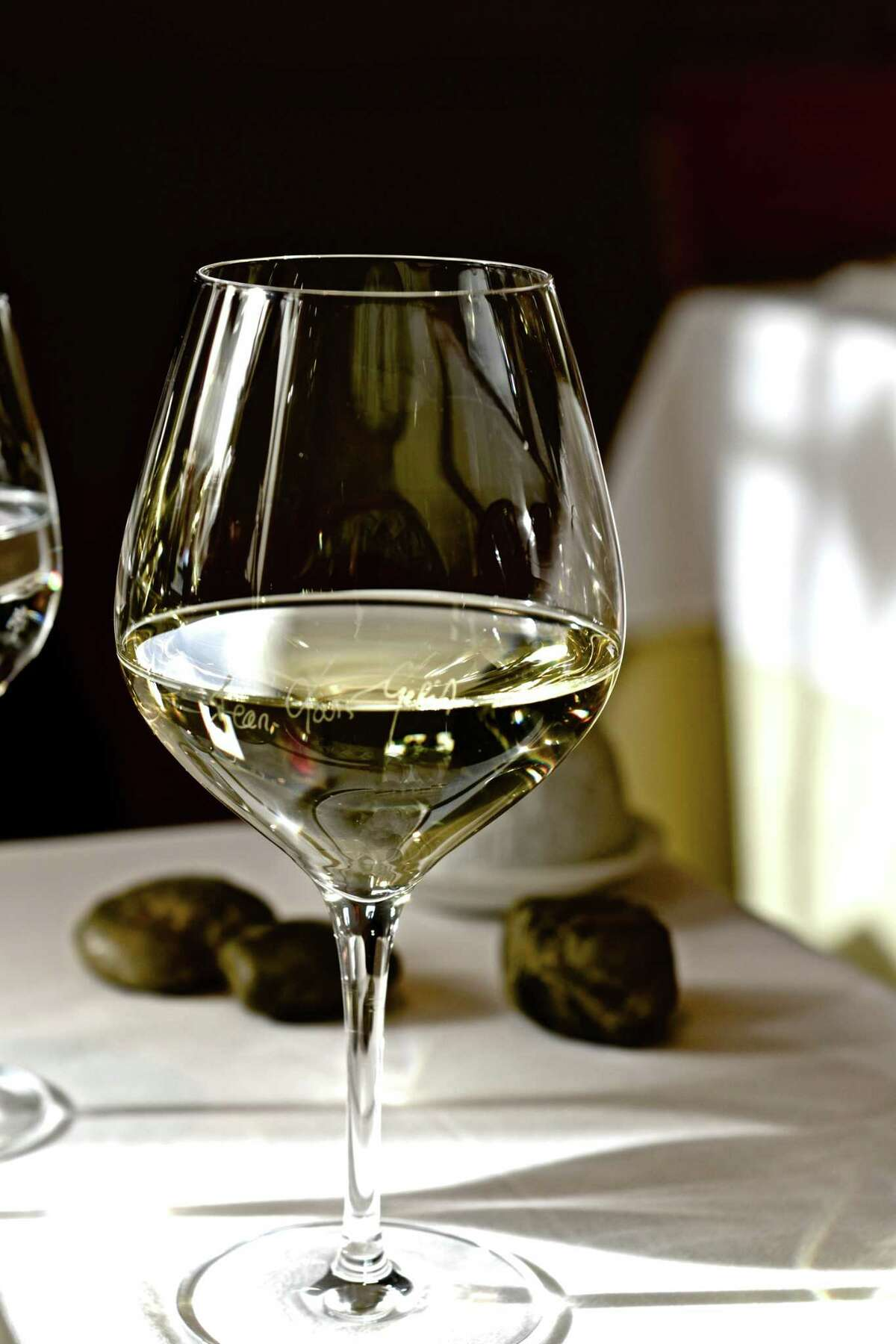 A white wine glass bearing Jean Louis Gehrin's name. The glasses are available on the chef's website.