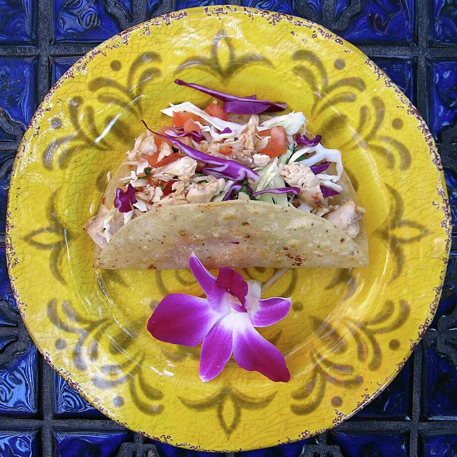 Mahi-Mahi taco with cabbage on a fried corn tortilla from La Fogata. Photo: Mike Sutter /San Antonio Express-News