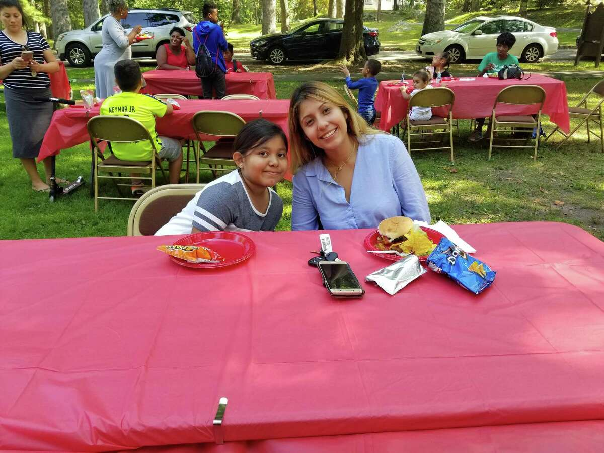 Families from the Family First program enjoy a late lunch at Bruce Park on Sept. 17.