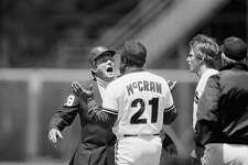 San Francisco Giants first base coach Tom McCraw argues with first base umpire Fred Brockland after Giants pinch runner Brad Wellman, right, was called safe then called out by Brocklander in a rundown at first base in the ninth inning of the Giants 1-0 victory over the Chicago Cubs at Candlestick Park, July 19, 1985 in San Francisco. (AP Photo/Paul Sakuma)