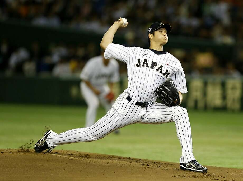 FILE - In this Nov. 19, 2015, file photo, Japan's starter Shohei Otani pitches against South Korea during the first inning of their semifinal game at the Premier12 world baseball tournament at Tokyo Dome in Tokyo. Shohei Otani is likely to leave Japan and sign with a Major League Baseball team after this season, multiple reports in Japanese media said Wednesday, Sept. 13, 2017, a move that would cost the 23-year-old pitcher and outfielder more than $100 million.  (AP Photo/Toru Takahashi, File) Photo: Toru Takahashi, AP