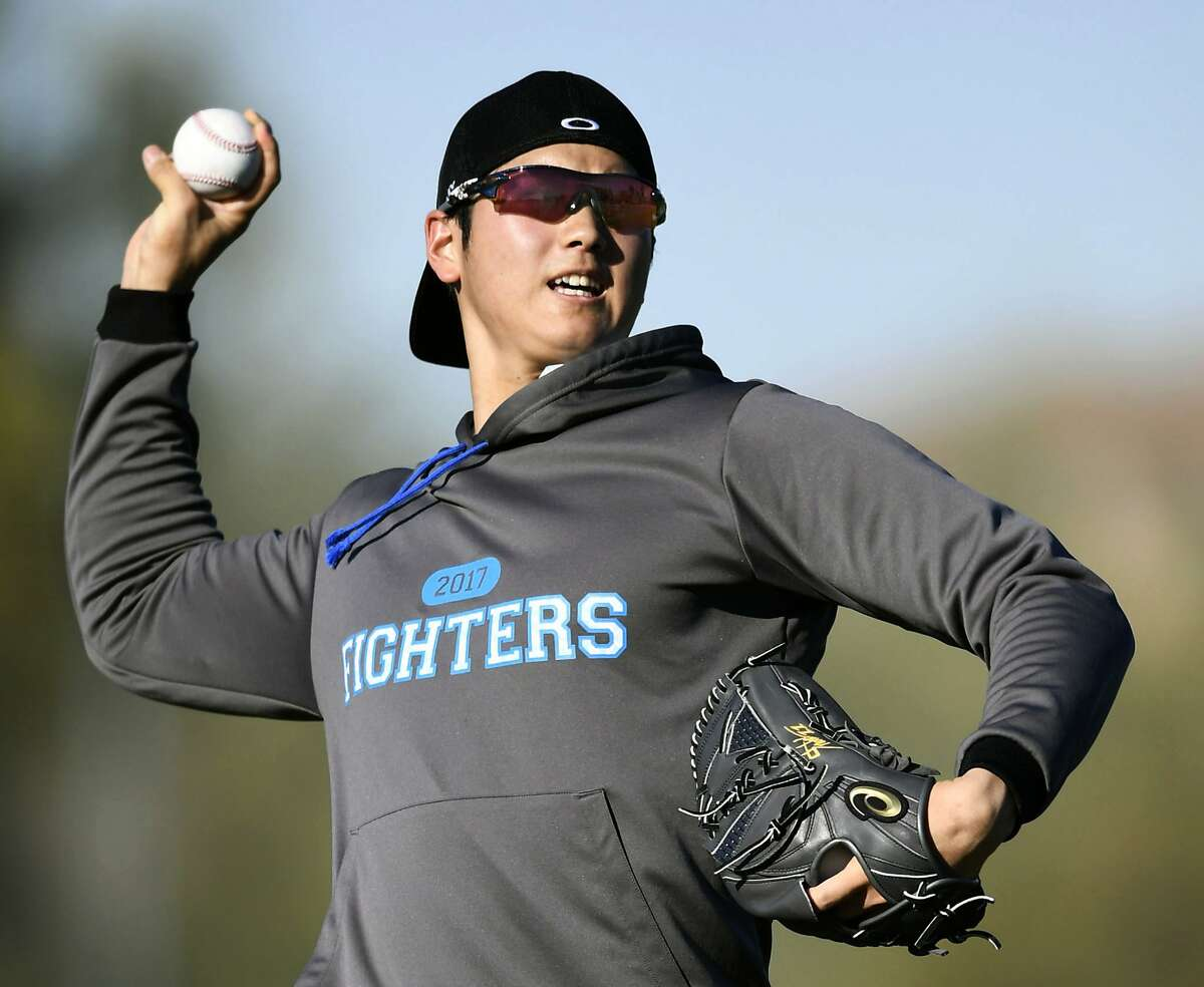 In this Jan. 31, 2017, file photo, Japanese baseball player Shohei Otani pitches the ball during the Nippon Ham Fighters' spring camp in Peoria, Ariz.