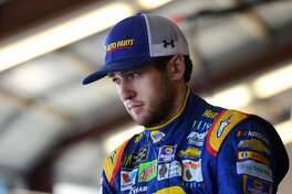 JOLIET, IL - SEPTEMBER 15:  Chase Elliott, driver of the #24 NAPA Brakes Chevrolet, stands in the garage area during practice for the Monster Energy NASCAR Cup Series Tales of the Turtles 400 at Chicagoland Speedway on September 15, 2017 in Joliet, Illinois.  (Photo by Jared C. Tilton/Getty Images)
