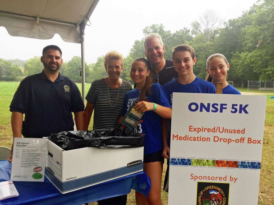 """Greenwich Police Officer Dan Paladino (L) helped collected unused prescription medications for safe disposal at the ONS Foundation for Clinical Research and Education's """"Race to Stop the Opioid Epidemic"""" on Sept. 17 in Greenwich with (from L to R) Joan Lunden, Kate Konigsberg, Jeff Konigsberg, Max Konigsberg and Kim Konigsberg. Kate and Max Konigsberg, now freshmen at Greenwich High, completed a capstone project on the opioid epidemic in eighth grade at Western Middle School. Photo: Contributed /"""
