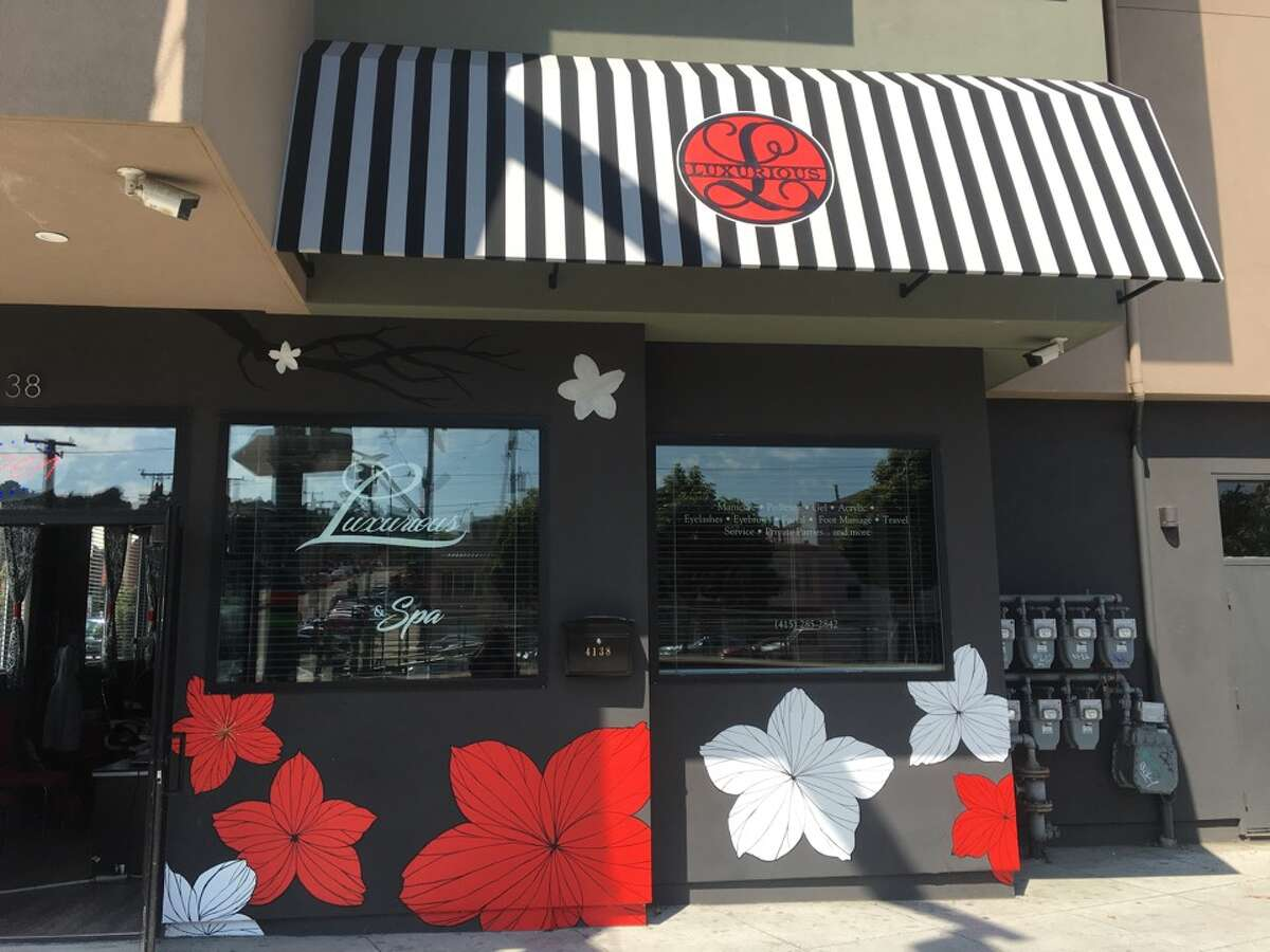 Luxurious Nail Boutique and Spa commissioned a mural for its storefront, but after complaints from the Housing Owners' Association, the nearly finished project has come to a halt.