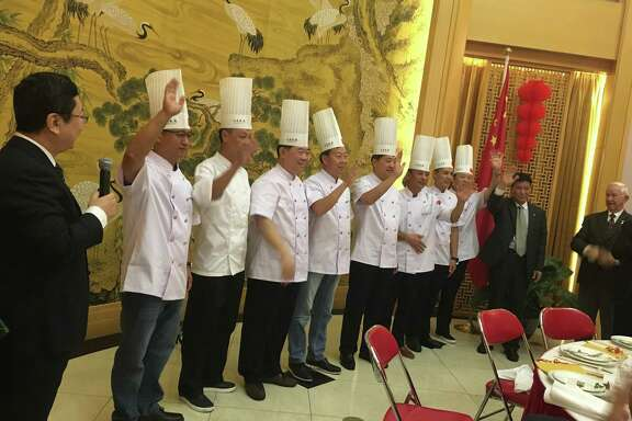Shandong chefs take a bow during a private dinner at the consul general's residence in Houston.