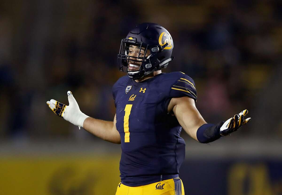 BERKELEY, CA - SEPTEMBER 16: Devante Downs #1 of the California Golden Bears reacts after making an interception against the Mississippi Rebels at California Memorial Stadium on September 16, 2017 in Berkeley, California. (Photo by Ezra Shaw/Getty Images)