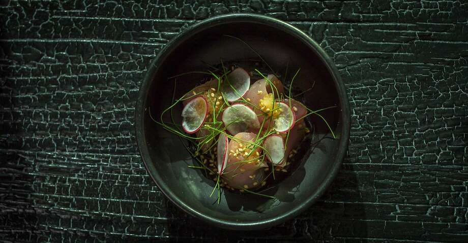 Bincho maguro (albacore), spicy ponzu, sesame seeds and micro chives at Robin. Photo: John Storey, Special To The Chronicle