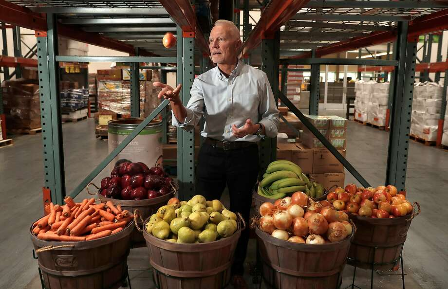 Paul Ash, executive director of the San Francisco-Marin Food Bank, in the group's S.F. building. Ash, who has helmed the group for 28 of its 30 years, has seen its reach widen from the destitute to providing meals and groceries to the working class. Photo: Michael Macor, The Chronicle