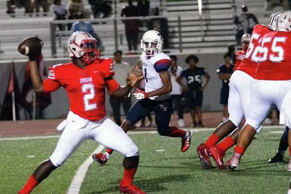 The Judson Rocket offensive line give quarterback Julon Williams (2) all day to find a receiver during their 62-21 win Friday over Roosevelt. Williams threw five TD passes and ran for two more.