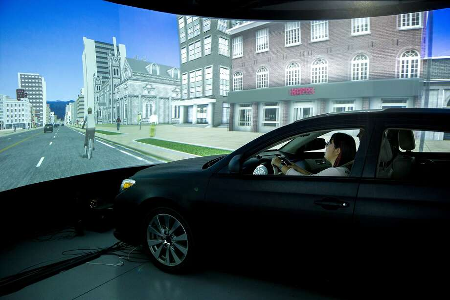 "Wendy Ju, senior research engineer at Stanford's Center for Design Research, drives in a simulation. ""Our techniques are theater-like ways of simulating the future, like live-action, improvisational role-play for science,"" she said. Photo: Santiago Mejia, The Chronicle"