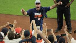 Astros starting pitcher Justin Verlander waves to fans after the team clinched the AL West by beating Seattle Mariners 7-1 at Minute Maid Park on Sept. 17, 2017, in Houston. Verlander was the winning pitcher in his home-field debut.