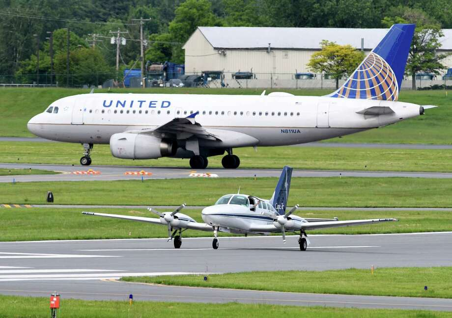 A Cape Air Cessna arrives from Boston as a United Airlines jet prepares for takeoff at Albany International Airport on Thursday, June 8, 2017, in Colonie, N.Y. (Will Waldron/Times Union) Photo: Will Waldron / 40040729A