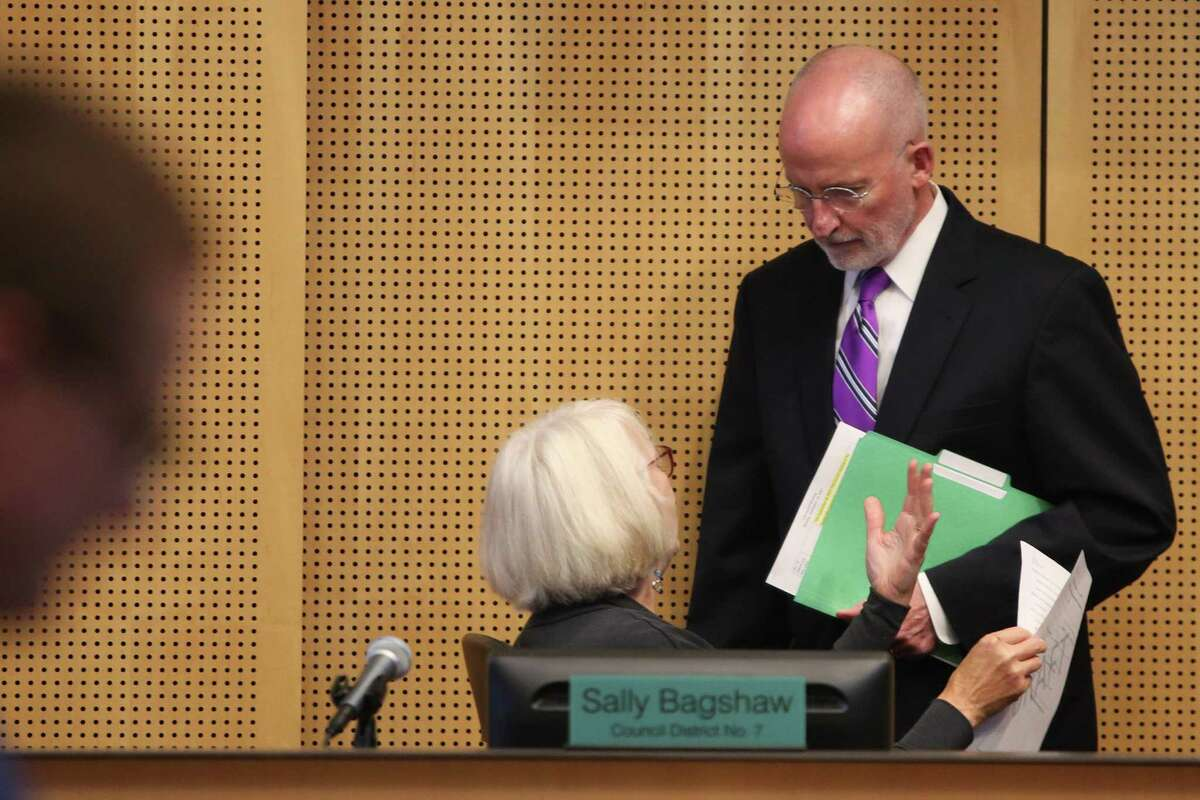 Seattle City Councilman Tim Burgess, right, talks with Sally Bagshaw prior to Burgess's final meeting as a council member, Sept. 18, 2017. He was voted by his fellow council members to be the next mayor of Seattle, taking the place of Bruce Harrell, who was sworn in last week, following Ed Murray's resignation. Harrell declined to hold the interim position.