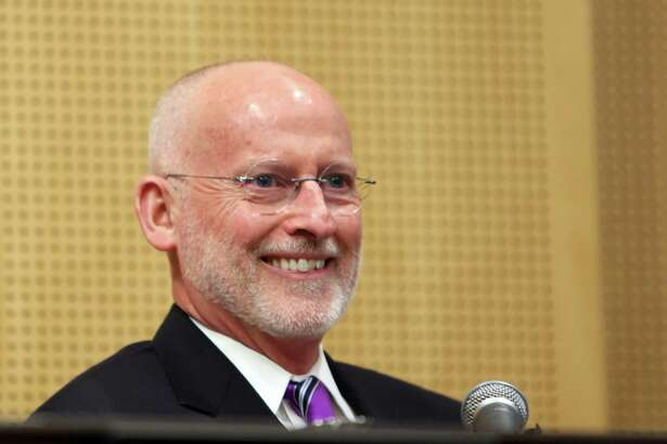 Seattle city councilmember Tim Burgess smiles as he is voted by his fellow councilmembers to be the next mayor of Seattle, taking the place of Bruce Harrell who was sworn in last week, following Ed Murray's resignation. Harrell declined to hold the interim position, Monday, Sept. 18, 2017.