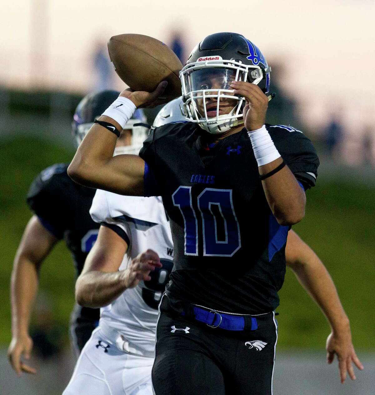 New Caney quarterback Jordan Cooper (10) throws under pressure during the first quarter of a non-district high school football game against Tomball Memorial at Texan Drive Stadium, Friday, Sept. 8, 2017, in New Caney.