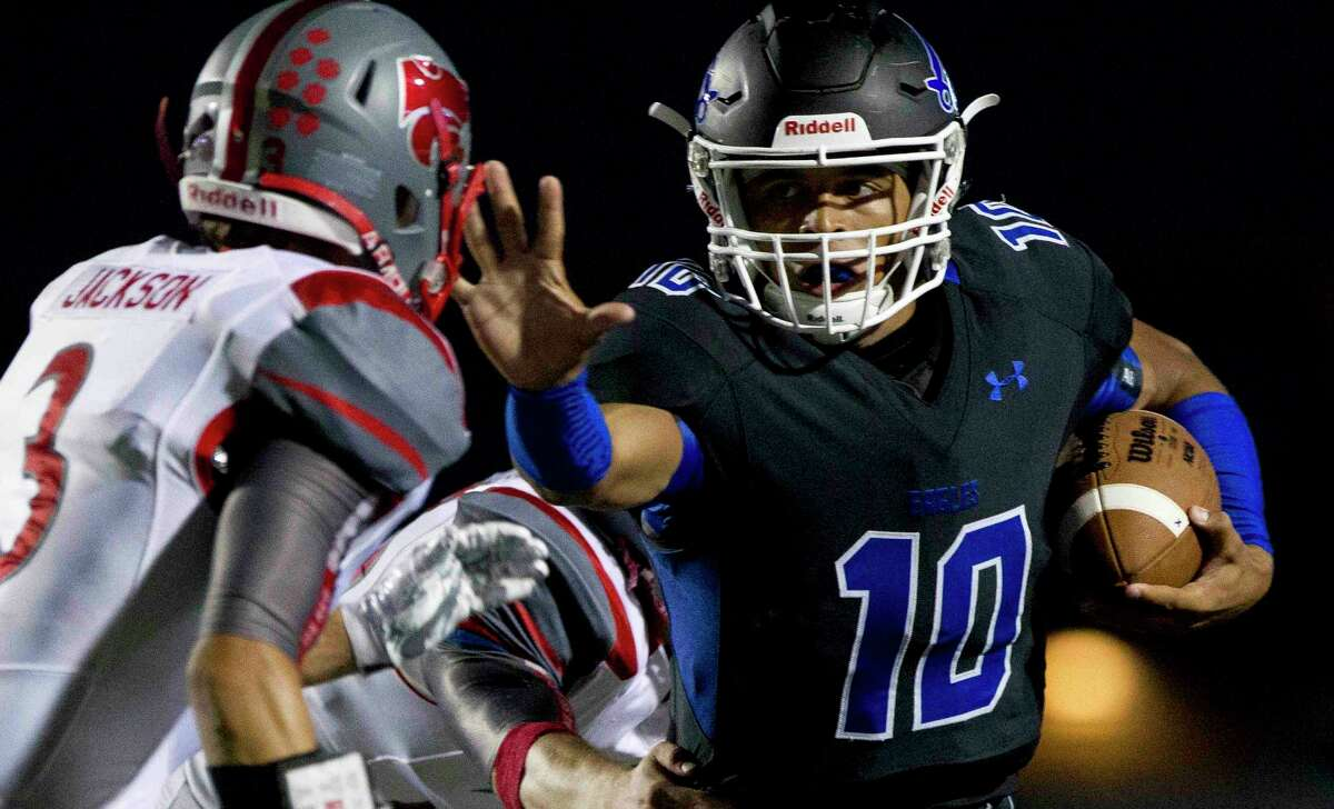 New Caney quarterback Jordan Cooper (10) stiff arms Splendora cornerback Zack Jackson (3) during the first quarter of a District 21-5A high school football game Thursday, Sept. 29, 2016, in Porter. Go to HCNpics.com to view more photos from the game.